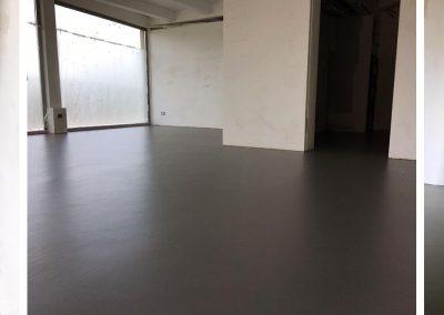 Pavimento in resina grigio scuro: salone, corridoi e stanze